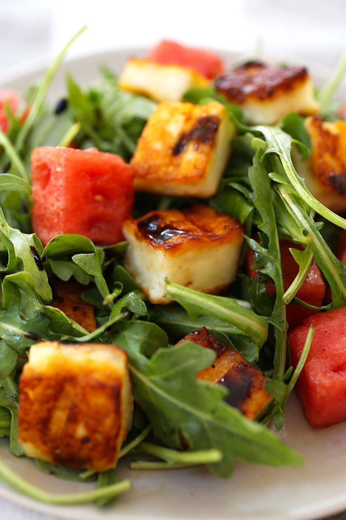 Grilled halloumi cheese with watermelon and arugula salad