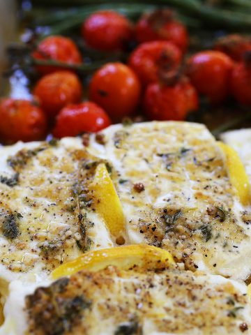 Baked halibut fish with vegetables.