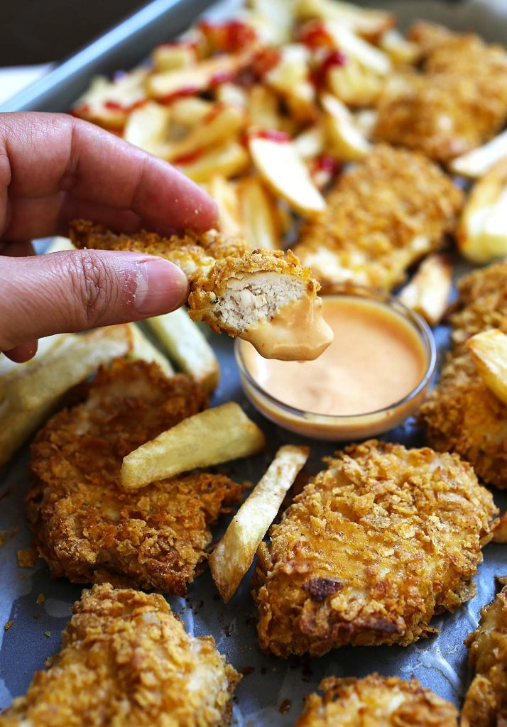 Baked chicken nuggets dipped in sauce