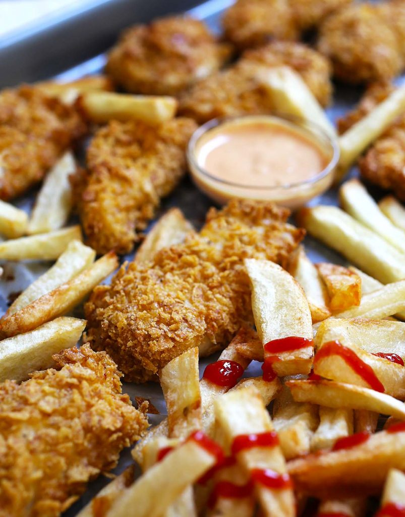 Baked chicken nuggets with sauce and ketchup