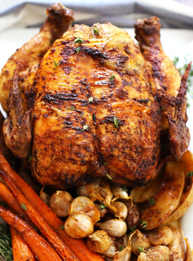Roasted chicken and vegetables on pan.