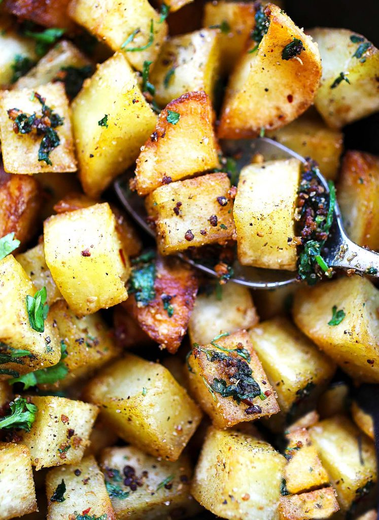 Spiced potatoes on plate.