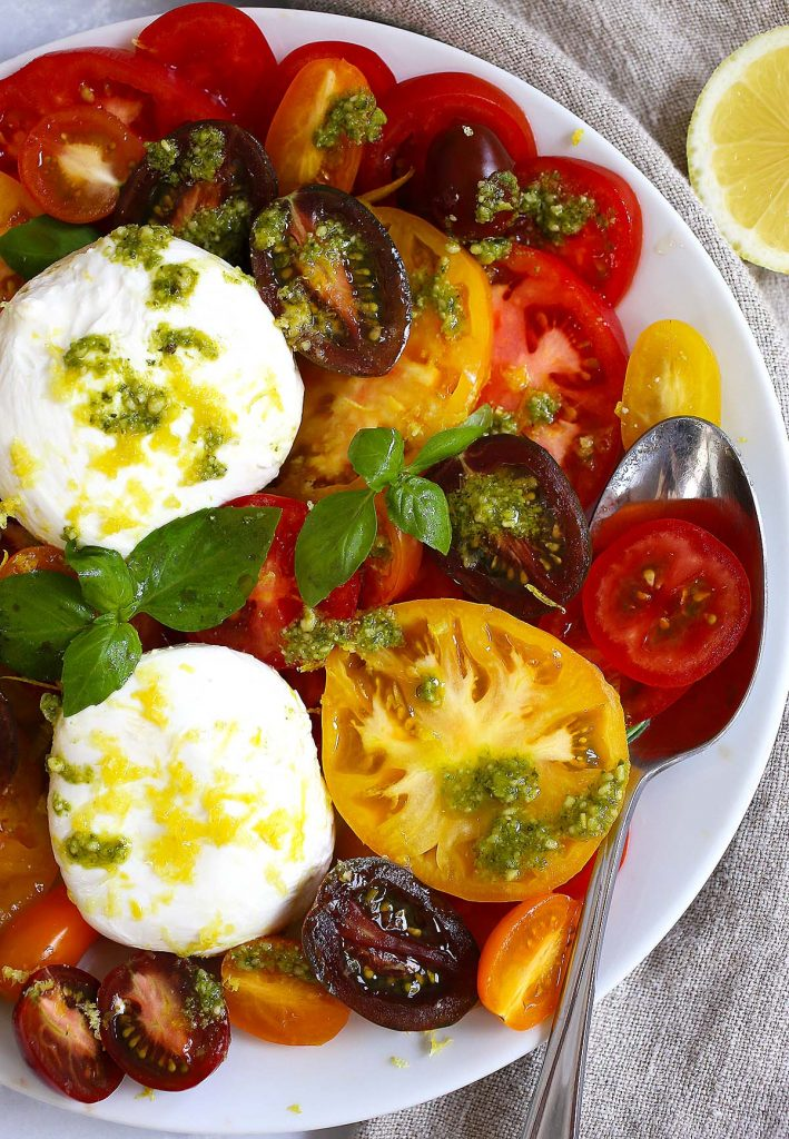 Tomato Burrata salad with Basil pesto sauce.