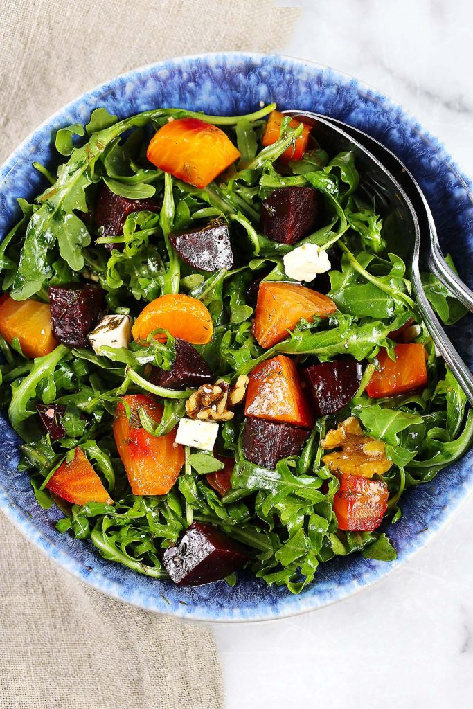 Salad bow with greens, beets and feta cheese.