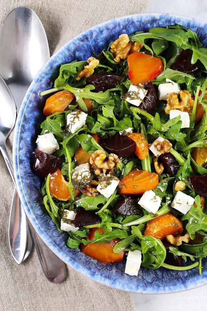 Mixed salad with feta, beets, walnuts and mandarins.