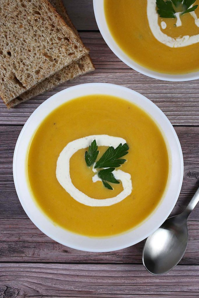 Butternut soup with cream with bread on the side.