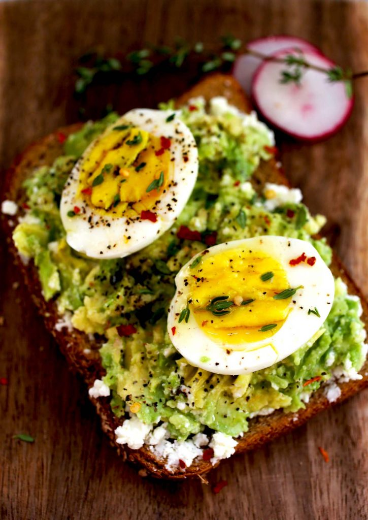 Eggs, feta cheese and avocado on toast.