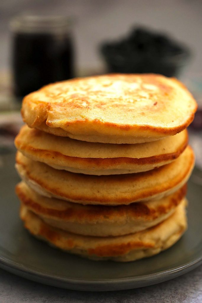 Stack of pancakes on a plate.