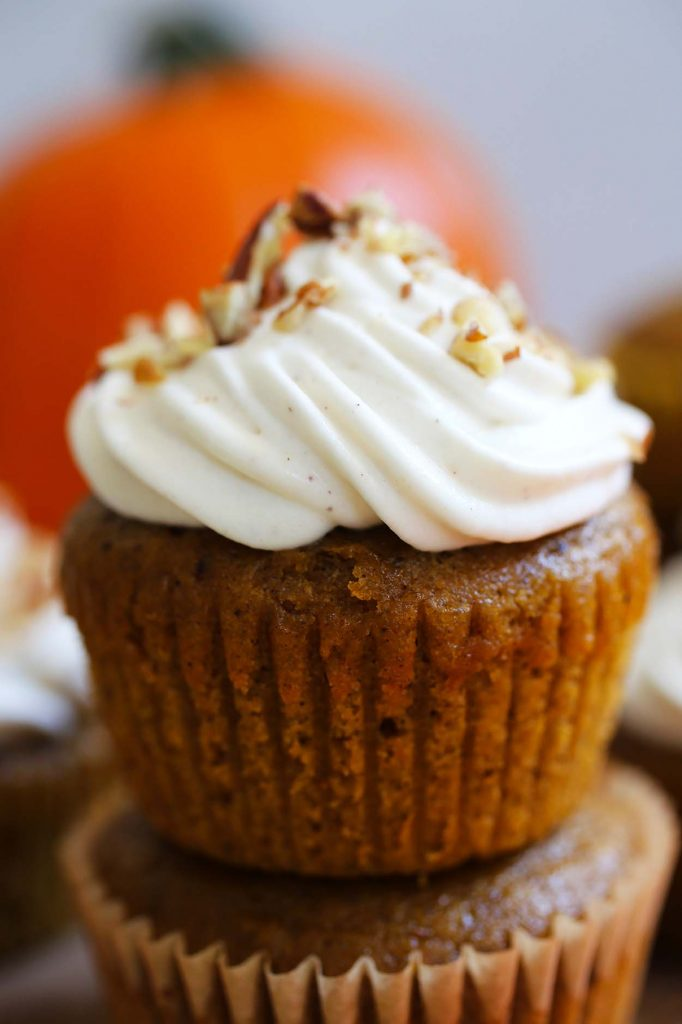 Pumpkin spice muffins with whipped cream.