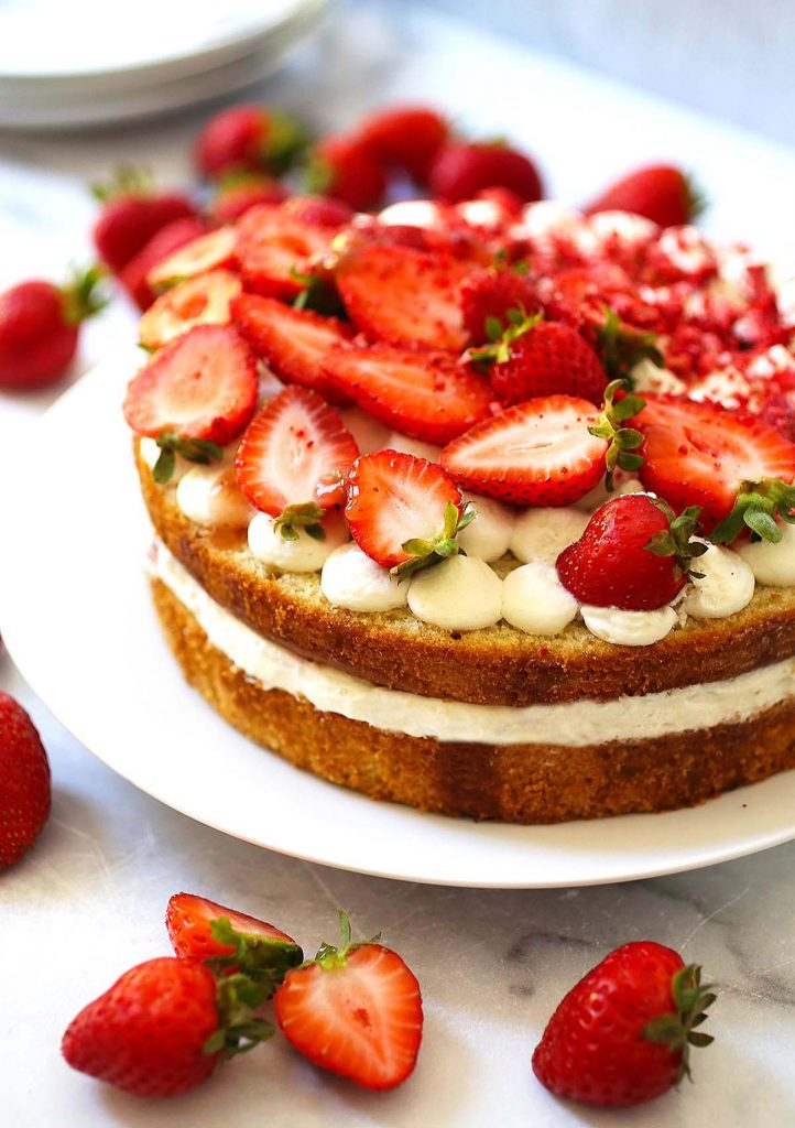 Strawberry cream cake on plate.