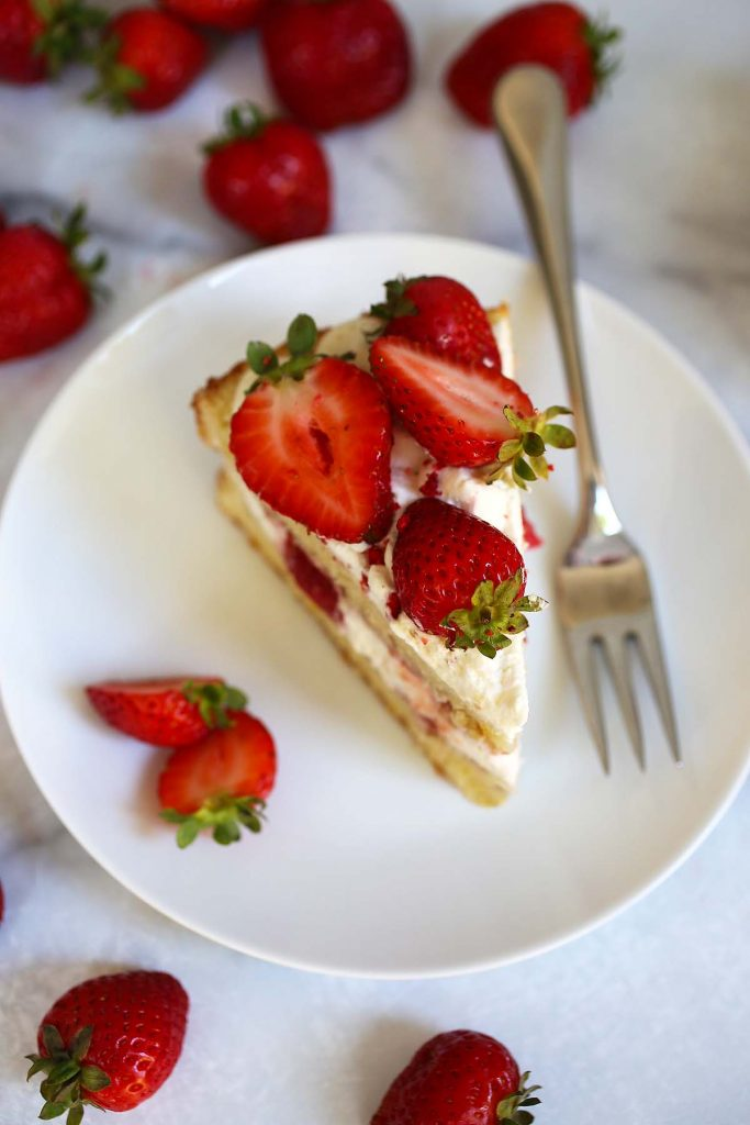Strawberry cream cake slice on plate.