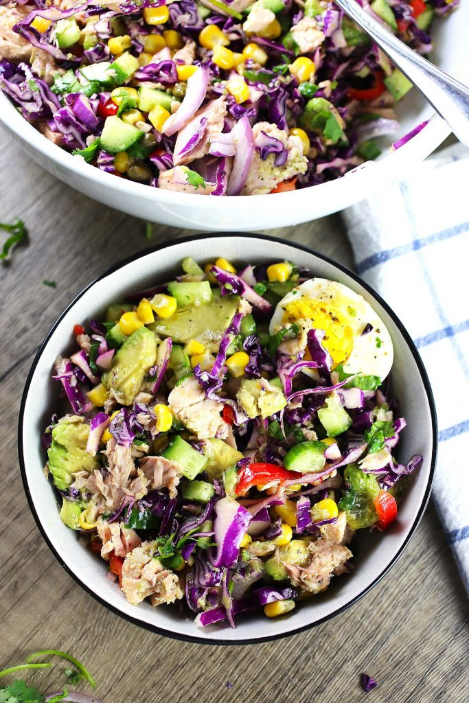 Mediterranean tuna salad with vegetables, boiled egg and lemon dressing.