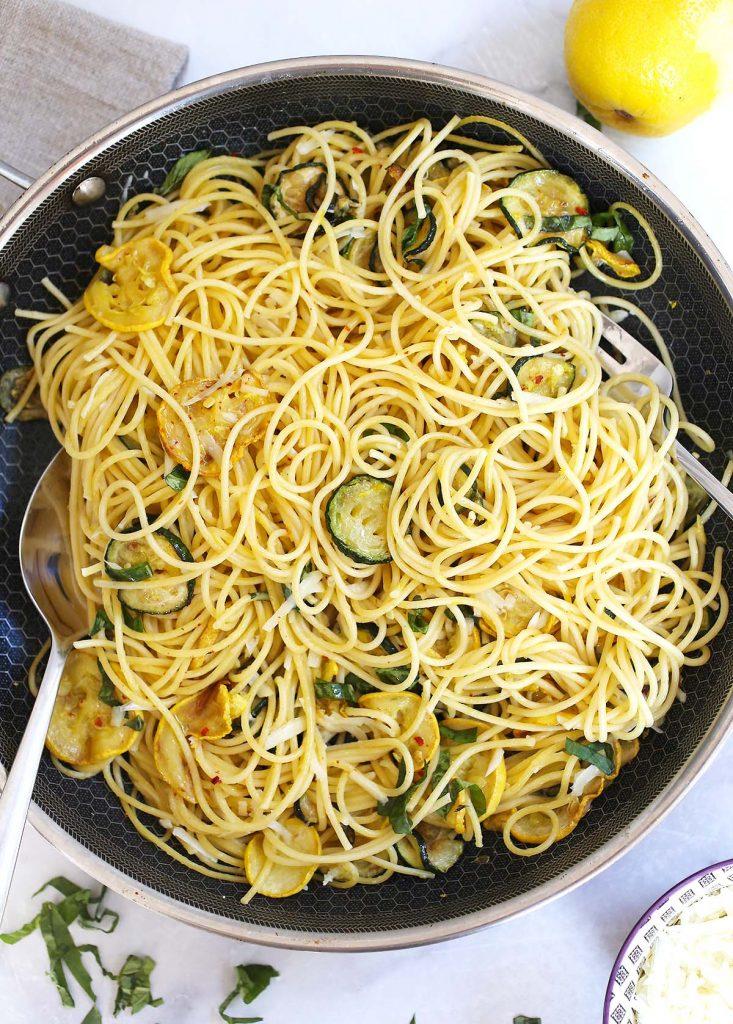 Spaghetti with zucchini in pan.