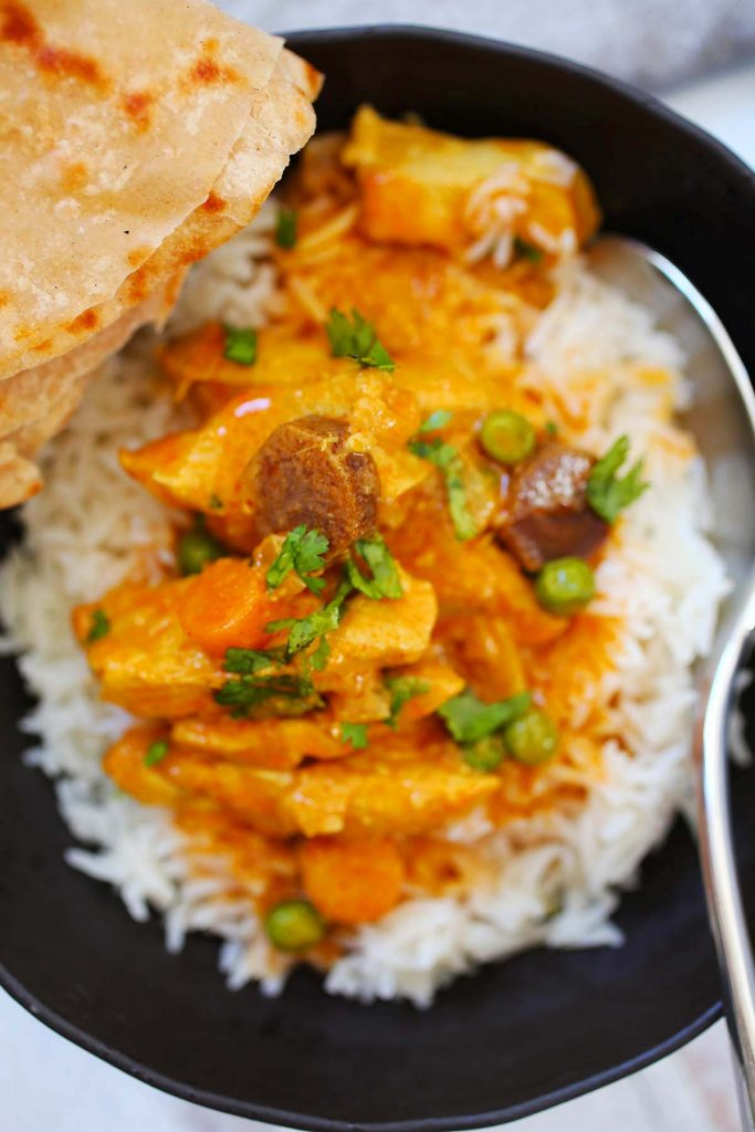 Chicken Vegetable Curry with white rice and naan bread.
