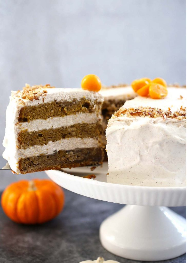 Pumpkin Spice Cake with Cinnamon Frosting on stand.
