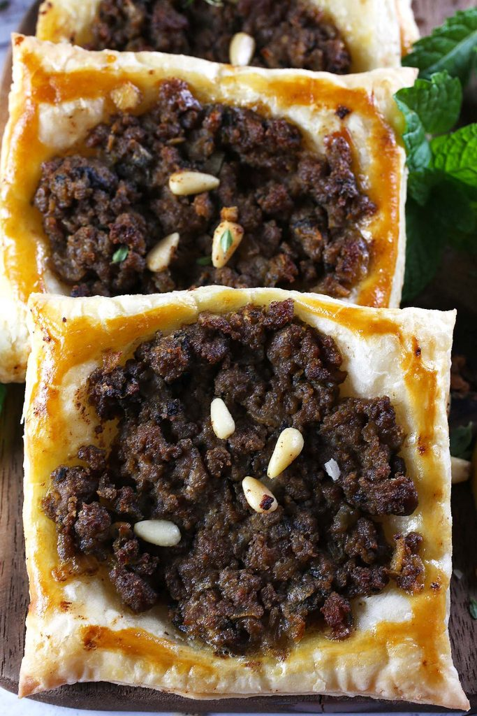 Spiced beef puffs with pine nuts.