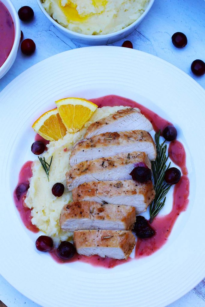 Cranberry orange chicken with mashed potatoes.