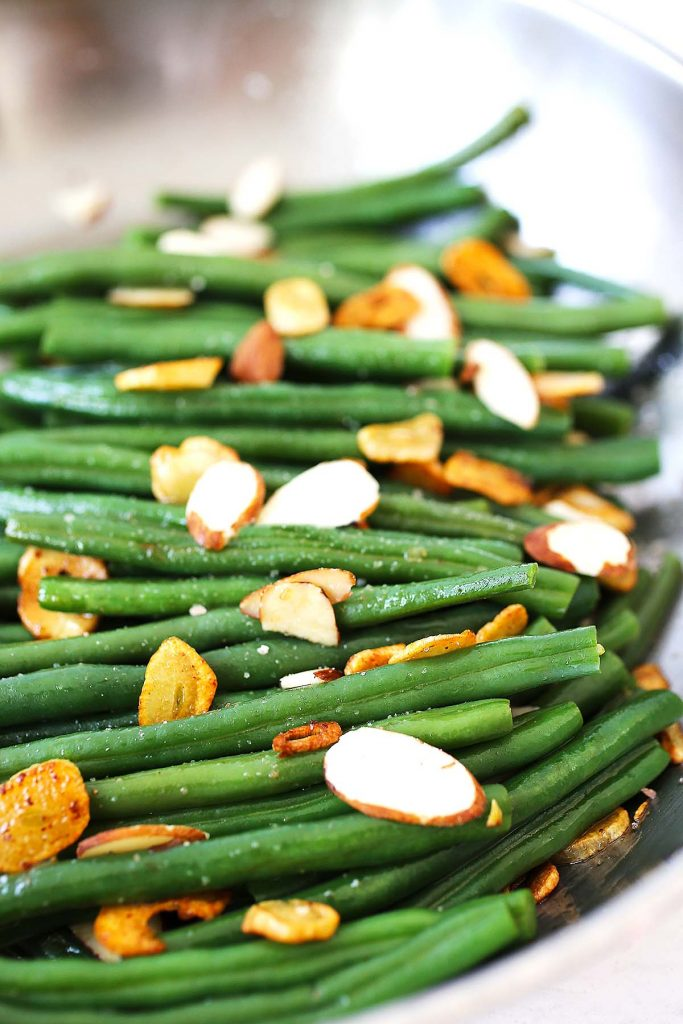 Almonds and garlic used in beans recipe.