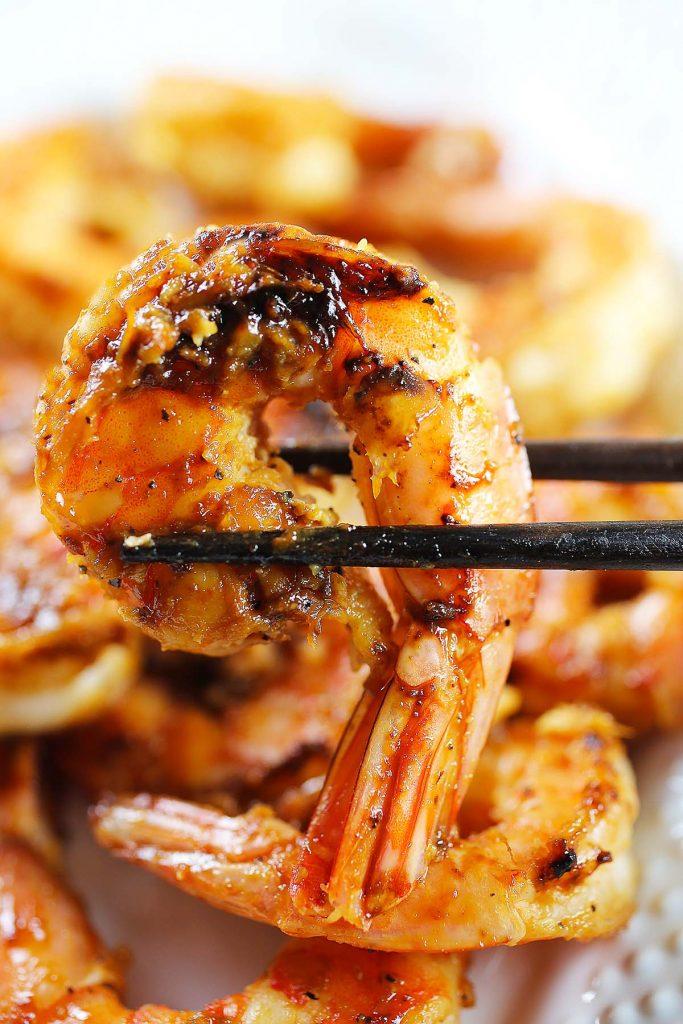 Shrimp in chopsticks.
