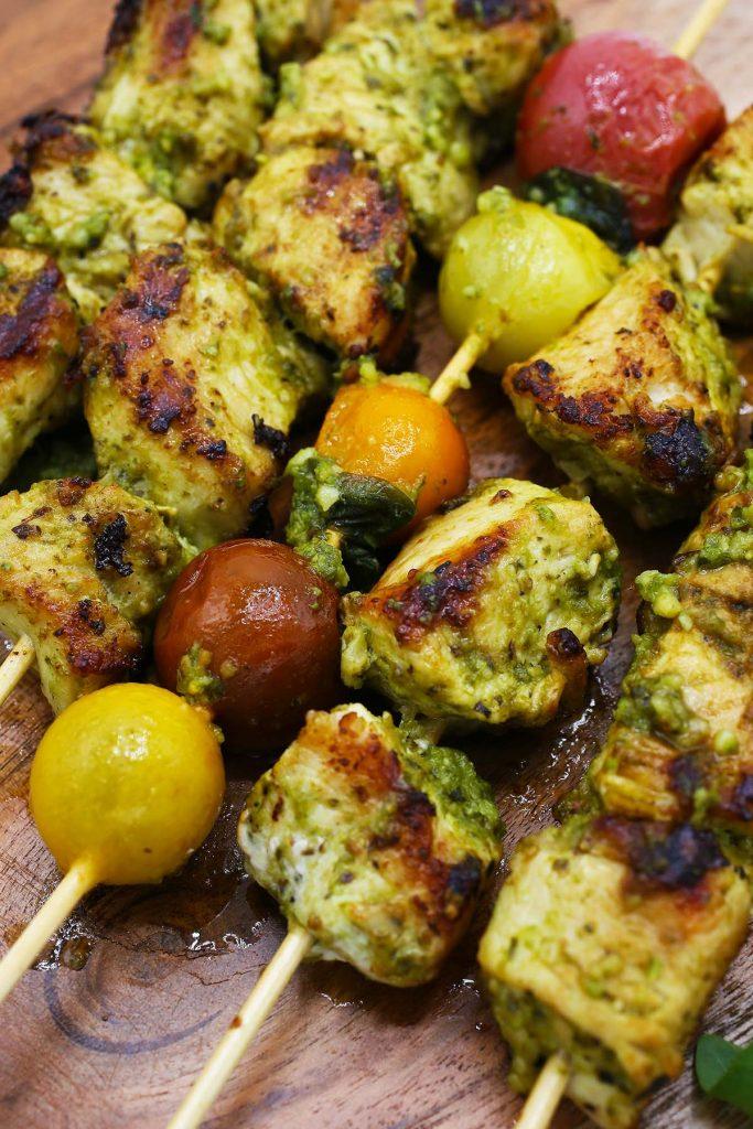 Chicken kebabs on skewers.