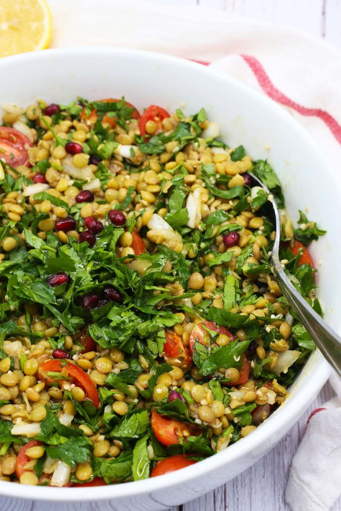 Lentil salad with tomatoes and fresh parsley.