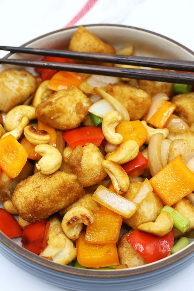 Chicken stir fry with cashews and bell peppers.