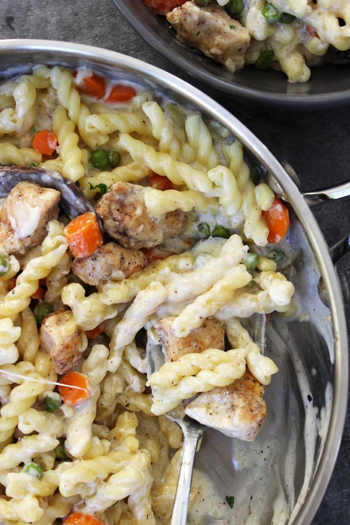 Chicken and  vegetables pasta in creamy sauce.