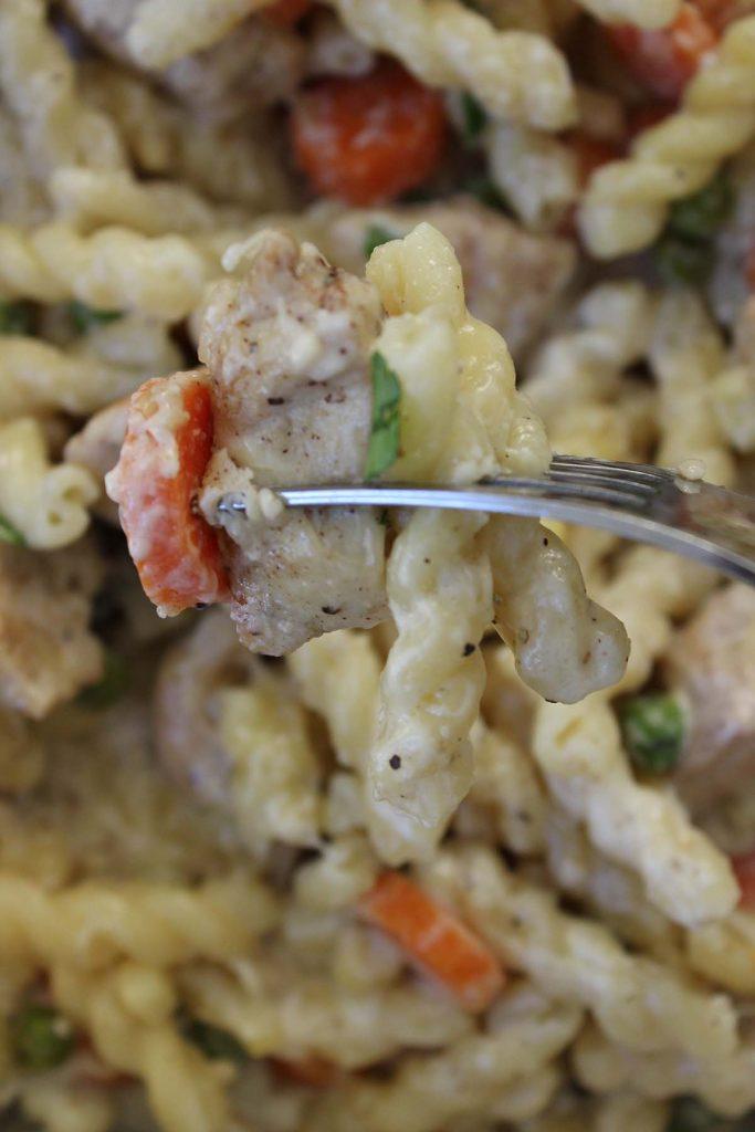 Chicken pasta on fork.