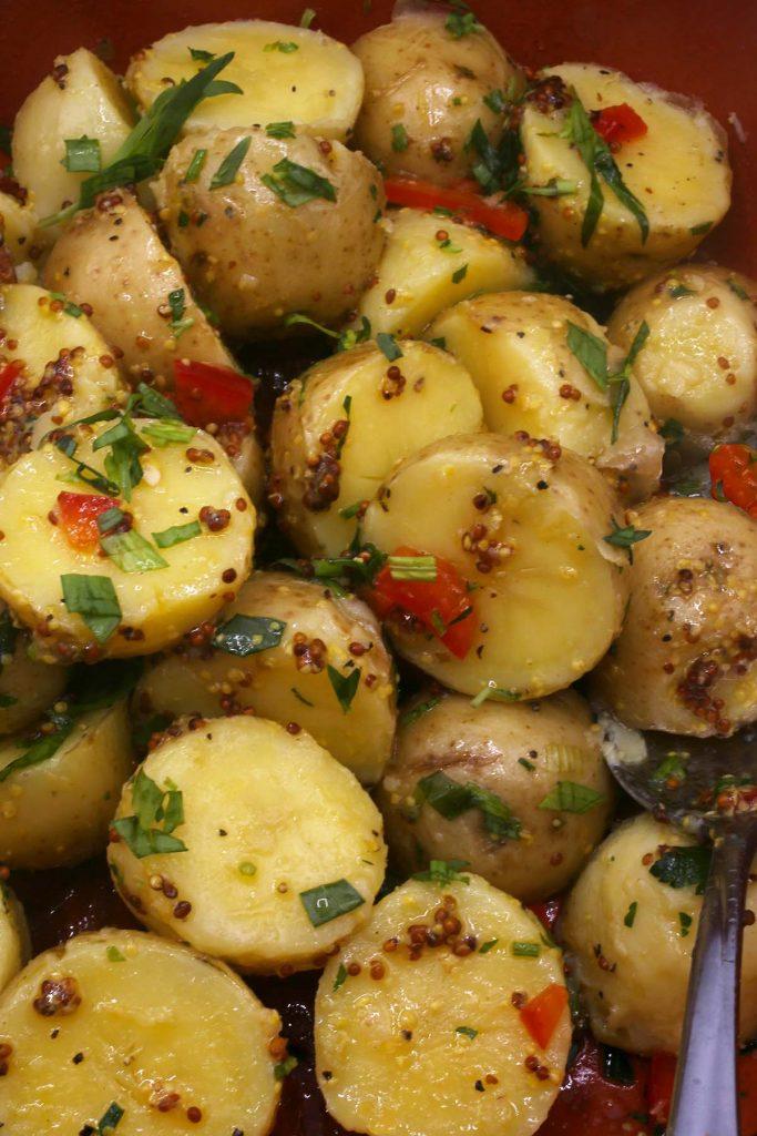Potato salad with Dijon mustard, tarragon and bell pepper.