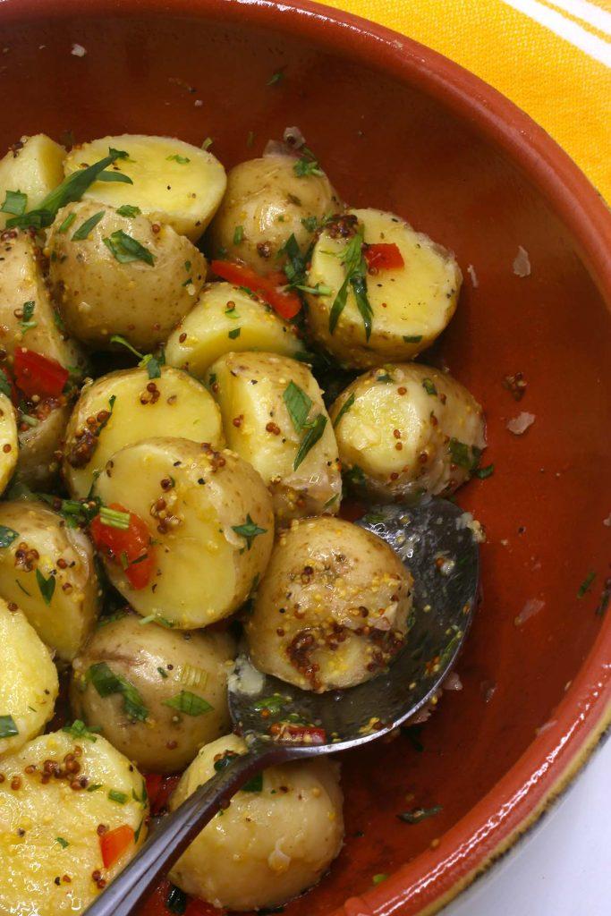 Potato salad with Dijon mustard and fresh herbs.